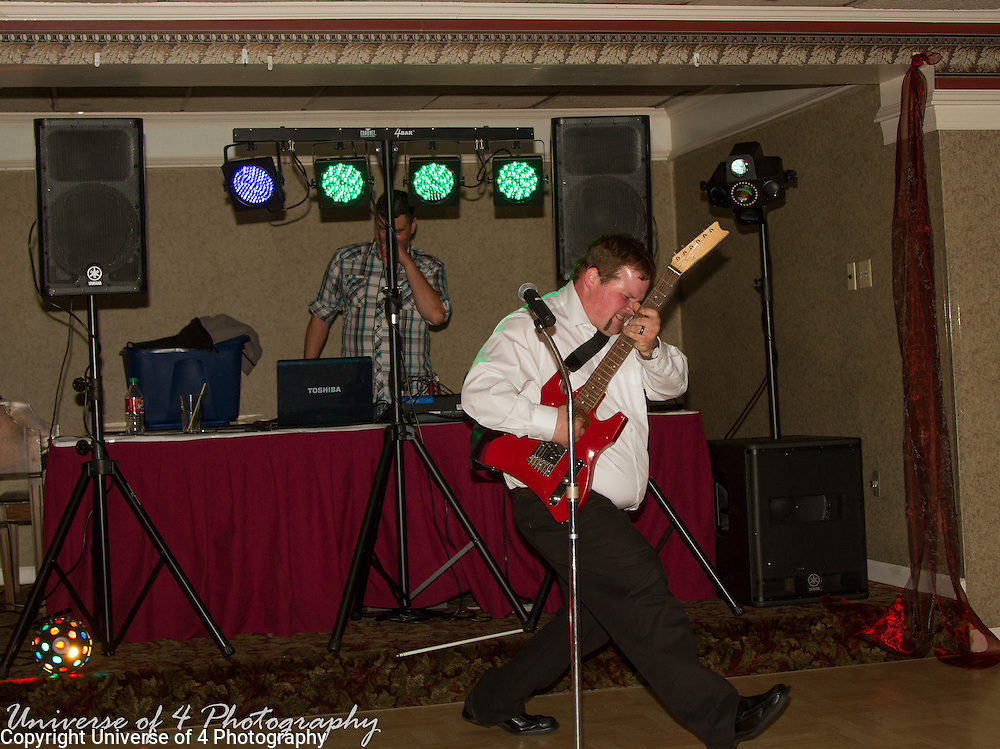 Groom rocking a guitar solo at the reception.The details make the wedding. Make sure that every detail of your special day is documented through images. After months/years of planning all you have left at the end of the day is your memories and hopefully numerous professional images.