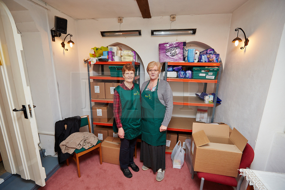 "© Licensed to London News Pictures.  30/05/2013. LITTLE CHALFONT, UK. Volunteers Clare Callaghan (L) and Gill Seymour (R) staff a food bank in St George's Church in Little Chalfont. Despite being one of the picturesque villages collectively known as the Chalfonts with multi-million pound houses and cottages, a significant percentage of the population is considered ""hard pressed"" by the local council. According to the Trussell Trust, the largest charity providing emergency food relief, use of their 325 food banks has tripled over the last year to 350,000. Photo credit: Cliff Hide/LNP"