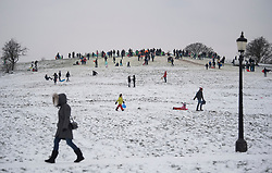 © Licensed to London News Pictures. 01/30/2018. London, UK. Members of the public take to Primrose Hill in London to enjoy the snow. Large parts of the UK are experiencing disruption as 'Storm Emma' hits, following Russian a cold front earlier in the week named 'The Beast From The East'. Photo credit: Ben Cawthra/LNP