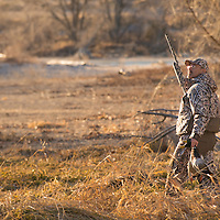 duck hunter in the field with ducks