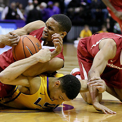 Jan 16, 2016; Baton Rouge, LA, USA; Arkansas Razorbacks forward Keaton Miles (55) and LSU Tigers forward Ben Simmons (25) battle for possession of a loose ball during the first half of a game at the Pete Maravich Assembly Center. Mandatory Credit: Derick E. Hingle-USA TODAY Sports