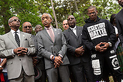 Rev. Al Sharpton speaks during a peace vigil at the spot where unarmed motorist Walter Scott was gunned down by police April 12, 2015 in North Charleston, South Carolina. About 100 people showed up for the brief vigil following a healing service at Charity Mission Baptist Church.
