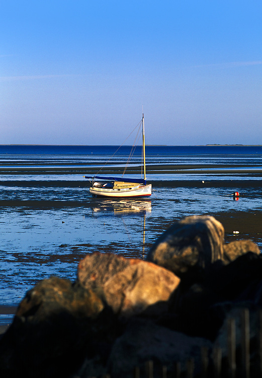 Sailboat moored in the tidal flats at low tide, Brewster, Cape Cod, Massachusetts