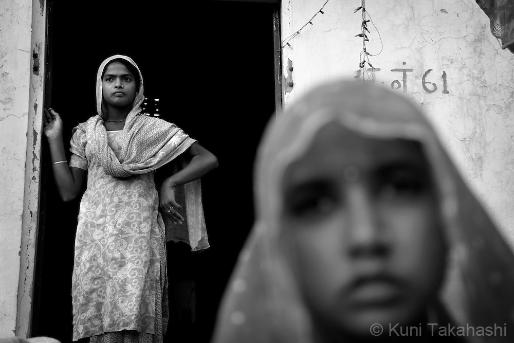 Pooja,18, and her Gudiya, 14, at their house in Ingonia, 40km north of Jaipul on Nov 16, 2009. Pooja was married when she was 15 and has a children while Gudiya is getting married in a few month. ...