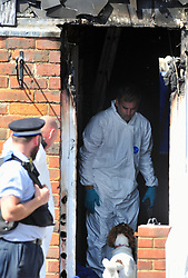 © Licensed to London News Pictures. 07/08/2018<br /> DEPTFORD, UK.<br /> Forensic teams use a forensic fire dog that can sniff out evidence of arson.<br /> 7 year old boy found dead after suspicious house fire at Adolphus Street, Deptford.   Arson investigation has been launched.<br /> Photo credit: Grant Falvey/LNP