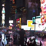"A panoramic view of Times Square, the major commercial intersection in Midtown Manhattan, New York City, at the junction of Broadway and Seventh Avenue and stretching from West 42nd to West 47th Streets. Times Square, iconified as ""The Crossroads of the World"" is the brightly illuminated hub of the Broadway theater district and one of the world's busiest pedestrian intersections. Times Square, New York, USA. Photo Tim Clayton.Note to Editors. This image is a composite of two images taken a split second apart and merged in editing."