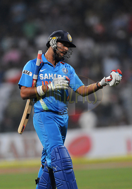 Yuvraj Singh of India walks back after getting out during the 2nd Airtel T20 Match between India and England held at The Wankhede Stadium in Mumbai on the 22nd December 2012..Photo by Pal PIllai/BCCI/SPORTZPICS ..Use of this image is subject to the terms and conditions as outlined by the BCCI. These terms can be found by following this link:..http://www.sportzpics.co.za/image/I0000SoRagM2cIEc