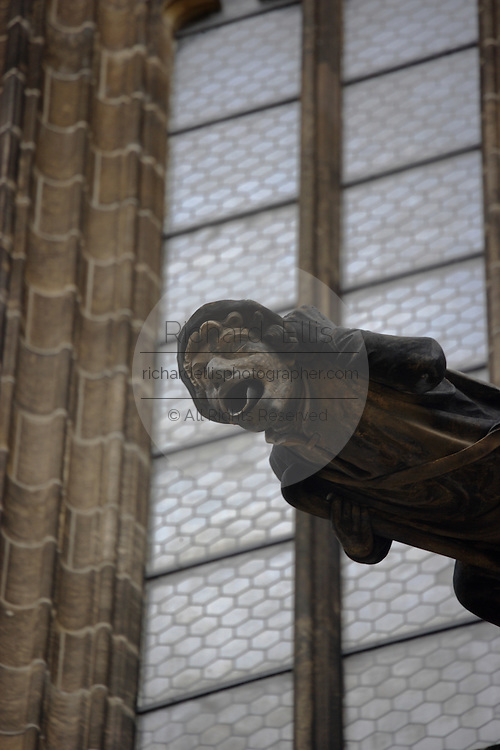 A gargoyle on St. Vitus's Cathedral in Prague Castle, Prague, Czech Republic. The castle, first constructed in the 10th century is the seat of government in the Czech Republic.