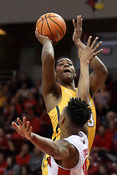 27 January 2018:  Mileek McMillan puts a shot over Phil Fayne during a College mens basketball game between the Valparaiso Crusaders and Illinois State Redbirds in Redbird Arena, Normal IL
