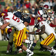 Notre Dame linebacker, Manti Teo fights off USC Offensive Guard Alex Parsons in an effort to tackle then Trojan, now New York Jet Joe McKnight in the 2009 Trojan 34-27 victory over the Irish.  Photo by Barry Markowitz, 10/17/09, 5pm