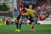 AFC Bournemouth's striker Glenn Murray holds off Watford FC midfielder Ben Watson during the Barclays Premier League match between Bournemouth and Watford at the Goldsands Stadium, Bournemouth, England on 3 October 2015. Photo by Mark Davies.
