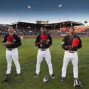 The Vancouver Canadians outfielders (left-right) Chris Carlson, Roemon Fields, and Jonathan Davis during the national anthems before the start of a home game at Nat Bailey Stadium vs. the Spokane Indians in game one of the NorthWest League divisional play-offs.