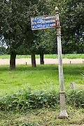 Ancient signpost to Landisson, La Bigotiere and Cigne in rural Normandy, France