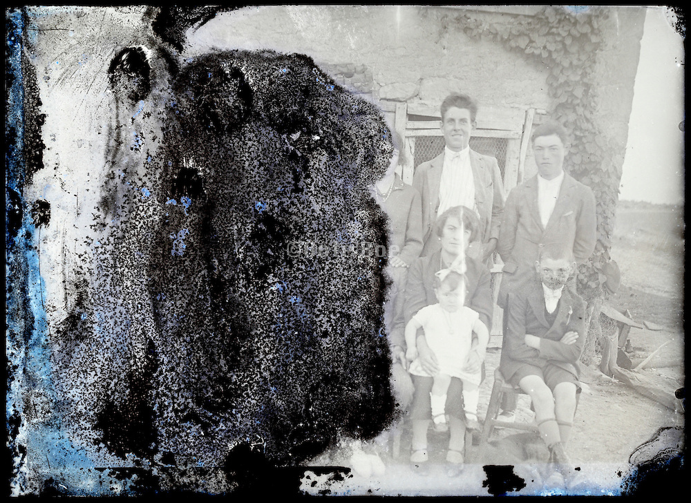 eroding glass plate photo of family group portrait