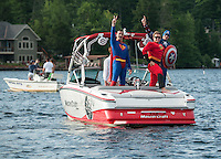"A Super Hero Mastercraft boat loaded with ""Superman"" Scott Johnson, ""The Incredible"" Rick Kelly and ""Captain America"" Dave Perkins with ""Mr Invisable"" Jessie Thompson there in spirit for the annual Winni Skiathon held early Saturday morning departing from Winnipesaukee Yacht Club.  (Karen Bobotas/for the Laconia Daily Sun)"