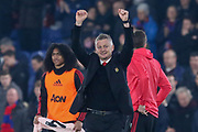 Manchester United interim Manager Ole Gunnar Solskjaer celebrates victory by punching the air during the Premier League match between Crystal Palace and Manchester United at Selhurst Park, London, England on 27 February 2019.