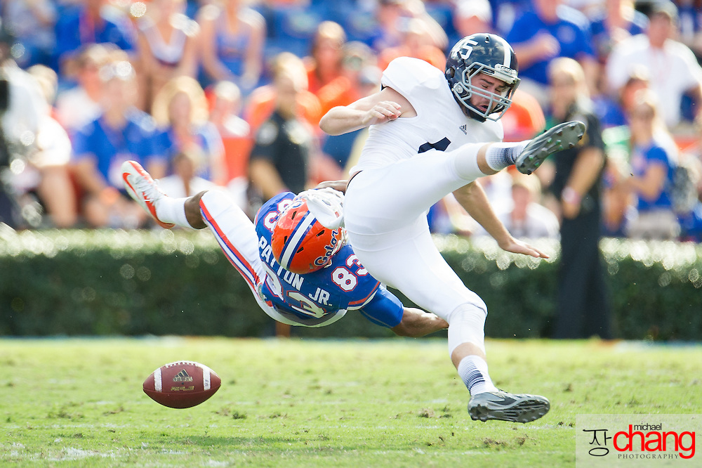 GAINESVILLE, FL - NOVEMBER 23:  Wide receiver Solomon Patton #83 of the Florida Gators hits punter Luke Cherry #45 of the Georgia Southern Eagles during a punt on November 23, 2013 at Ben Hill Griffin Stadium in Gainsville, Florida.  (Photo by Michael Chang/Getty Images) *** Local Caption *** Solomon Patton; Luke Cherry