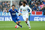 Leicester City forward Shinji Okazaki tracks Swansea City midfielder Leroy Fer during the Barclays Premier League match between Leicester City and Swansea City at the King Power Stadium, Leicester, England on 24 April 2016. Photo by Alan Franklin.