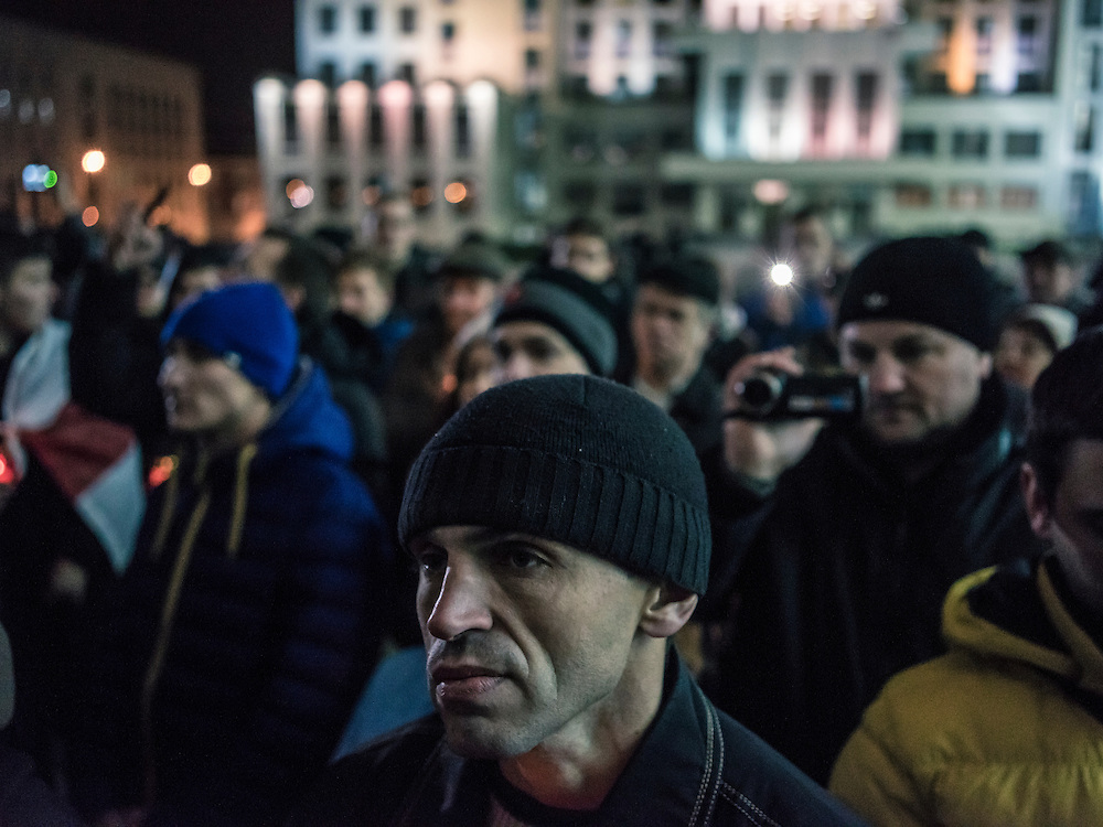 People participate in a rally organized by Mikalai Statkevich, a former opposition presidential candidate and political dissident, to commemorate the nineteenth anniversary of a referendum which enshrined authoritarian changes in Belarus's constitution on Tuesday, November 24, 2015 in Minsk, Belarus.