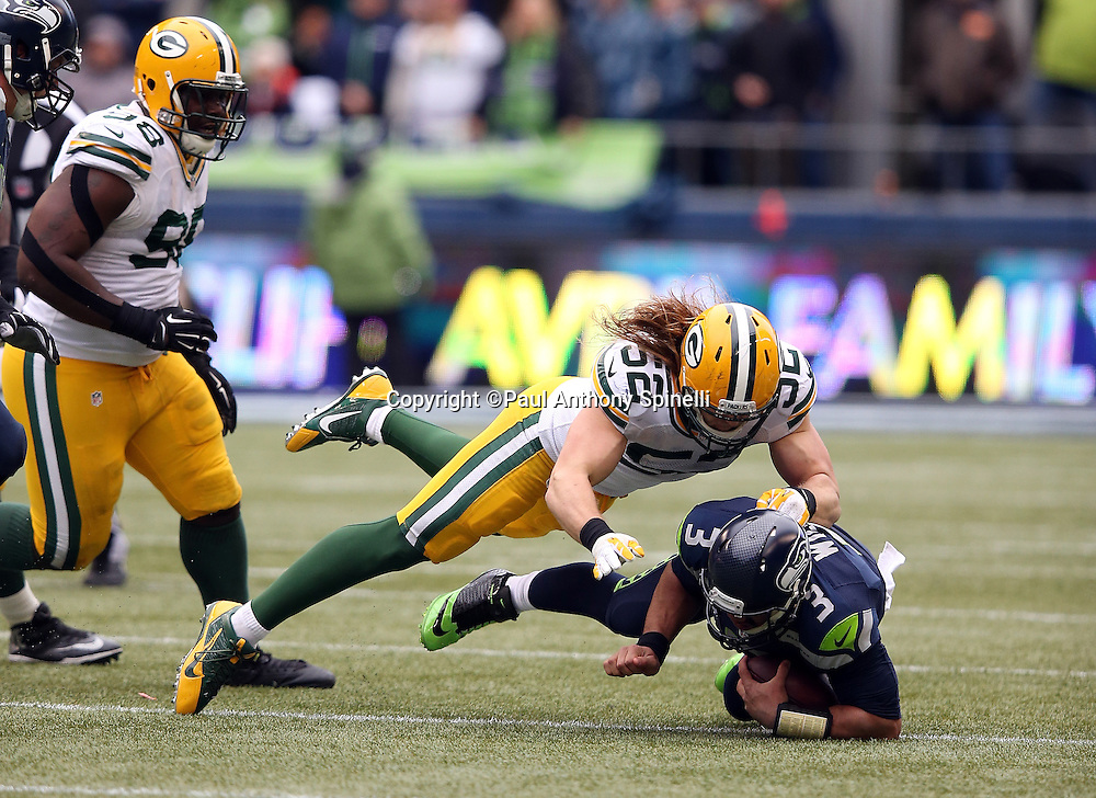 Green Bay Packers outside linebacker Clay Matthews (52) sacks Seattle Seahawks quarterback Russell Wilson (3) for a loss of 5 yards plus another 15 yards due to a personal foul penalty on the Seattle Seahawks during the NFL week 20 NFC Championship football game against the Seattle Seahawks on Sunday, Jan. 18, 2015 in Seattle. The Seahawks won the game 28-22 in overtime. ©Paul Anthony Spinelli