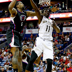 Dec 28, 2016; New Orleans, LA, USA;  New Orleans Pelicans guard Jrue Holiday (11) shoots over Los Angeles Clippers center DeAndre Jordan (6) during the second half of a game at the Smoothie King Center. The Pelicans defeated the Clippers 102-98. Mandatory Credit: Derick E. Hingle-USA TODAY Sports