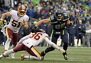 Nov 5, 2017; Seattle, WA, USA; Seattle Seahawks tight end Jimmy Graham (88) is defended by Washington Redskins inside linebacker Will Compton (51) and free safety D.J. Swearinger (36) during an NFL football game at CenturyLink Field. The Redskins defeated the Seahawks 17-14.
