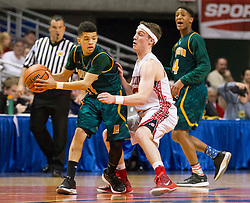 Huntington guard Tavian Dunn-Martin (11) is guarded by Hurricane guard Dylan Tinsley (13) during a semi-final game at the Charleston Civic Center.