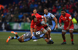 Saracens Brad Barritt (left) and Cardiff Blues' Samu Manoa in action during the Heineken Champions Cup match at Cardiff Arms Park.
