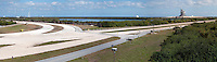 US, Florida. John F. Kennedy Space Center. Stitched panorama, view from Observation Gantry. Crawlerway and Launch Pad 39B on the left and 39A on the right.