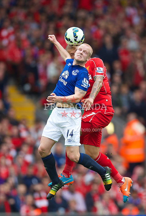 LIVERPOOL, ENGLAND - Saturday, September 27, 2014: Liverpool's Martin Skrtel in action against Everton's Steven Naismith during the Premier League match at Anfield. (Pic by David Rawcliffe/Propaganda)