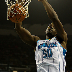 March 30, 2011; New Orleans, LA, USA; New Orleans Hornets center Emeka Okafor (50) dunks against the Portland Trail Blazers during the first half at the New Orleans Arena.    Mandatory Credit: Derick E. Hingle