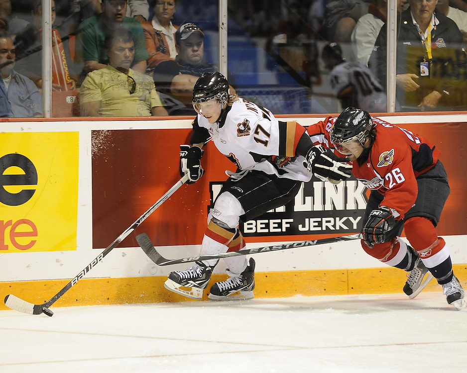 Giffen Nyren of the Calgary Hitmen holds off Kenny Ryan of the Windsor Spitfires in Game 4 of the 2010 MasterCard Memorial Cup in Brandon, MB on Monday May 17. Photo by Aaron Bell/CHL Images