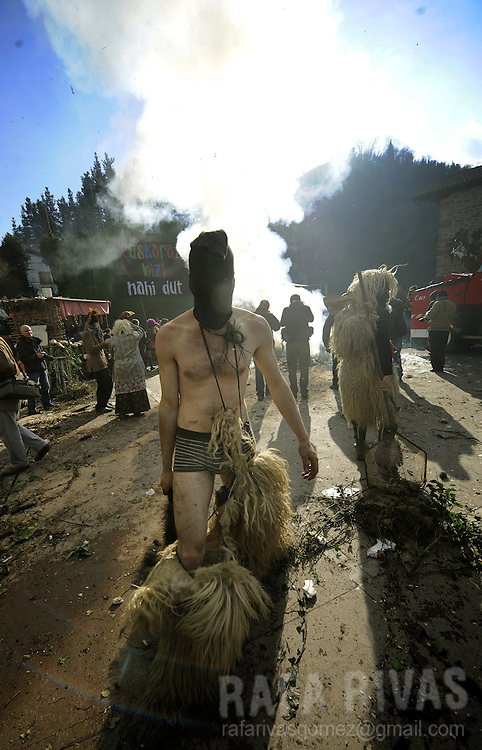 Masked men take part in the ancient carnival of Ituren, in the northern Spanish province of Navarra province, on January 30, 2012.