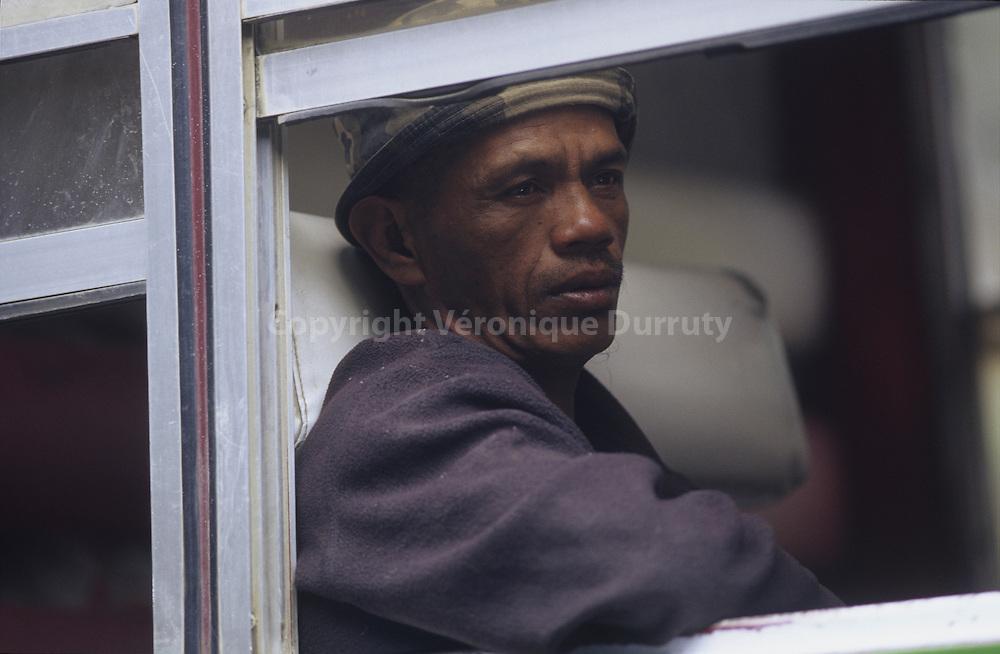 BONTOC MAN IN A PUBLIC BUS IN THE CORDILLERA, NORTH LUZON, THE PHILIPPINES
