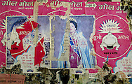 Defaced picture images of Nepal's King Gyanendra and Queen Komal adorn a wall bearing advertisements for Noodles near the town of Sita Parthy, in southern Nepal Friday April 23, 2004. The nation of 26 million seems to offer laboratory conditions for a revolution: an undemocratic government under a feud-riven royal family; poverty exaerbated by a perceptiuon of government is remote and corrupt; a feudal system where a handful of rich landlords exploit millions of poor. In the mountains of Nepal, one of the world's last full-blown Maoist revolutions is thriving/forging ahead/gaining ground. (AP Photo/Elizabeth Dalziel)
