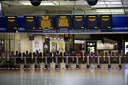 © Licensed to London News Pictures. 27/12/2013. London, UK. Closed train platforms at Victoria Railway station in London. Many National Rail services have been cancelled and disrupted as a result of very strong winds and rain. Southeastern Railways have cancelled all trains as a precaution until midday today and no rail services are running to Gatwick Airport this morning. Photo credit : Vickie Flores/LNP