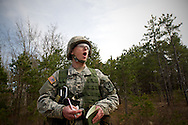 Cadet Jon Broderick yells at members of his squadron to move casualties off the road during a training exercise at a spring field training exercise in Camp Edwards, Mass., on April 9, 2011. The weekend field training is designed to prepare third year cadets for a month long summer field training program.