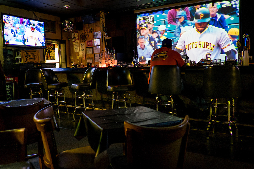 A lone patron watches the Pittsburgh Pirates play baseball on the big screen at the Valley Hotel Bar and Grill outside of Clairton Pa.<br /> <br /> Built in 1863 and was originally called The Granger Hotel, it was positioned in between two of the largest steel mills in the area. The Valley Hotel has long been the local watering hole for mill workers after a long day, or night, of work.<br /> <br /> With the local mills running at just a fraction of full capacity, the bar has stuggled in recent years.