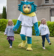 Emer and Aine Carew from Lattin Cullen Co. Tipperary with OLTAN , HSE Comunity Games mascot  at the HSE Community Games National finals 2010 held at the AIT, (Athlone Institute of Technology). Photo:Andrew Downes.