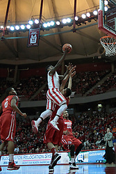15 February 2014:  Bobby Hunter leaps to the side or Auston Barnes as he lays the ball towards the hoop during an NCAA Missouri Valley Conference (MVC) mens basketball game between the Bradley Braves and the Illinois State Redbirds  in Redbird Arena, Normal IL.