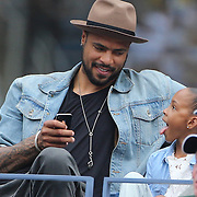 NBA basketball player Tyson Chandler and his daughter Sacha-Marie watching the Maria Sharapova, Russia,  against Marion Bartoli, France, during the US Open Tennis Tournament, Flushing, New York. USA. 5th September 2012. Photo Tim Clayton