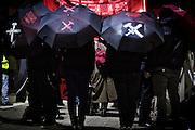 Frankfurt | 07 October 2016<br /> <br /> Am Freitag (07.10.2016) versammelten sich in Wetzlar etwa 80 Neonazis aus dem Umfeld der NPD, von neonazistischen Freien Kameradschaften, dem sog. Freien Netz Hessen und der Identit&auml;ren Bewegung zu einer Demonstration &quot;gegen &Uuml;berfremdung&quot;. Die geplante Demo-Route war von etwa 1600 Anti-Nazi-Aktivisten blockiert, daher wurde den Neonazis eine neue Demoroute durch Altstadt und Innenstadt von Wetzlar vorbei am Wetzlarer Dom zugewiesen. Auch hier stellten sich den Rechten immer wieder Aktivisten in den Weg.<br /> Hier: Aktivisten aus dem Umfeld der Neonazi-Netzwerks Freies Netz Hessen (FN Hessen) stehen vor Beginn der Demo auf einem Parkplatz am Bahnhof von Wetzlar und verstecken sich hinter Transparenten, sie tragen Schirme mit der Aufschrift &quot;M&auml;rkte brauchen Grenzen&quot; und gekreuztem Hammer und Schwert.<br /> <br /> photo &copy; peter-juelich.com<br /> <br /> FOTO HONORARPFLICHTIG, Sonderhonorar, bitte anfragen!