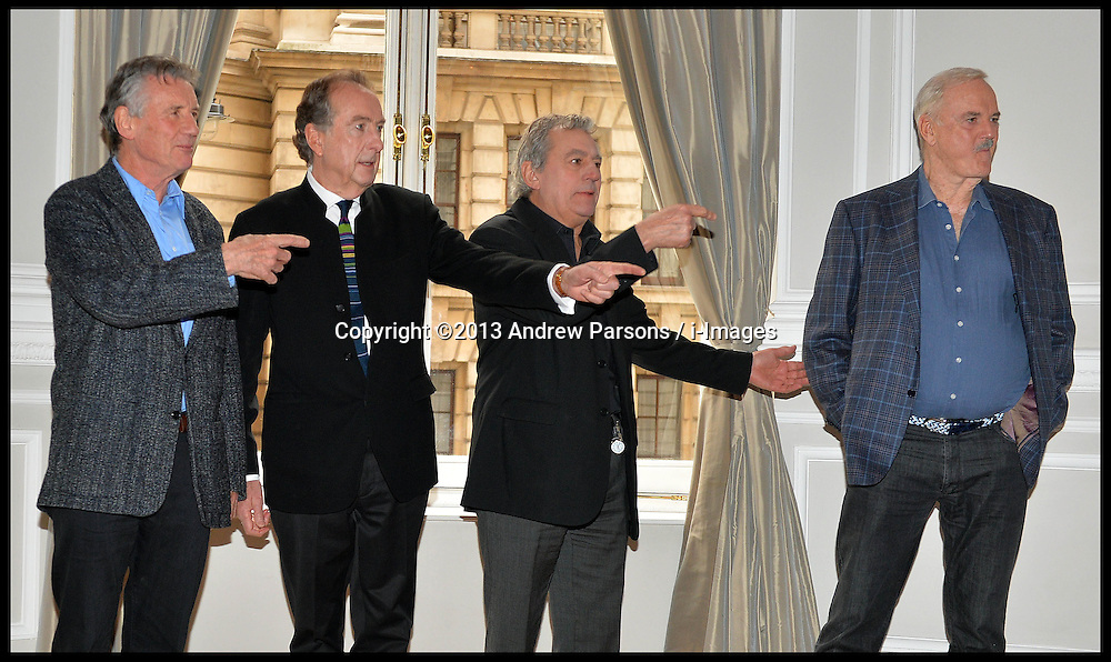 L to R Michael Palin, Eric Idle, Terry Jones and John Cleese tell Terry Gilliam (out of shot) where to stand for photographers  at the <br /> Photocall for the Monty Python reunion. London, United Kingdom. Thursday, 21st November 2013. Picture by Andrew Parsons / i-Images
