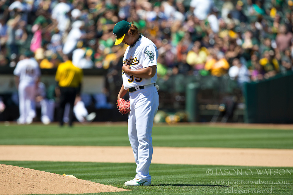 OAKLAND, CA - MAY 19: Hideki Okajima #39 of the Oakland Athletics stands behind the pitcher's mound before pitching against the Kansas City Royals during the seventh inning at O.co Coliseum on May 19, 2013 in Oakland, California. The Oakland Athletics defeated the Kansas City Royals 4-3. (Photo by Jason O. Watson/Getty Images) *** Local Caption *** Hideki Okajima