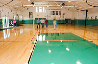 Councilor Armand Bolduc, Director Kevin Dunleavy, Councilor Bob Hamel and Asst Director Amy Lovesik following the ribbon cutting for the new gym floor at Laconia Community Center Monday morning.  (Karen Bobotas/for the Laconia Daily Sun)
