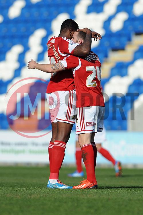 Bristol City's Martin Paterson celebrates his goal with Bristol City's Jay Emmanuel-Thomas - Photo mandatory by-line: Dougie Allward/JMP - Mobile: 07966 386802 22/03/2014 - SPORT - FOOTBALL - Colchester - Colchester Community Stadium - Colchester United v Bristol City - Sky Bet League One