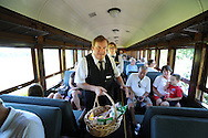 LANSDALE, PA - AUGUST 24: Tom O'Brien (center) and Catherine Keim (R) attend to passengers aboard the New Hope and Ivyland Railroad during Founders Day August 24, 2013 in Lansdale, Pennsylvania. The New Hope and Ivyland Railroad made special trips as part of Founders Day from Lansdale to Souderton. (Photo by William Thomas Cain/Cain Images)