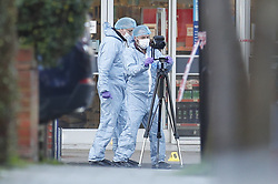 © Licensed to London News Pictures. 03/02/2020. London, UK. Scenes of crime officers gather evidence outside Boots where the assailant was shot in Streatham High Road the day after he stabbed two people. Sudesh Amman, who was released from prison recently for terror offences, was under active police surveillance at the time of the attack - which police think was an Islamist-related terrorist incident. Photo credit: Peter Macdiarmid/LNP
