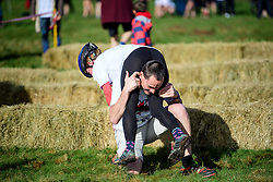 © Licensed to London News Pictures. 05/03/2017. Dorking, UK. A competitor attempts to lift his wife before taking part in the 2017 Wife Carrying Race in Dorking, Surrey.  The race, which is run over a course of 380m, with both men and women carry a 'wife' over obstacles,  is believed to have originated in the UK over twelve centuries ago when Viking raiders rampaged into the northeast coast of  England carrying off any unwilling local women.  Photo credit: Ben Cawthra/LNP