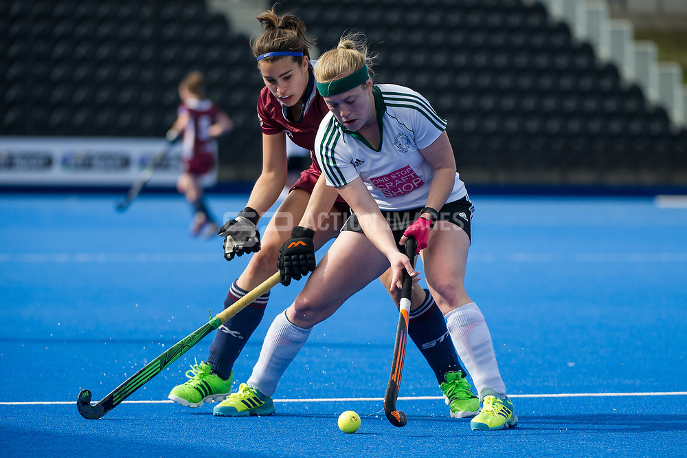 Buckingham's Alex Naughalty is watched by Libby Sherriff of Wimbledon. Wimbledon v Buckingham - Investec Women's Hockey League Finals, Lee Valley Hockey & Tennis Centre, London, UK on 23 April 2017. Photo: Simon Parker